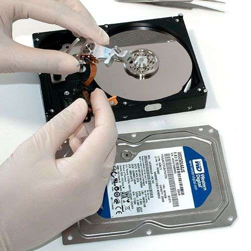 Hard drive's spindle being repaired by a technician